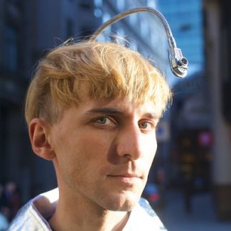 Neil Harbisson is a British artist and Cyborg Activist. He is the world's first legally recognized cyborg. He was born colour-blind – but thanks to an antenna implanted into his skull, colour becomes audible for him. With his Cyborg Foundation, founded in 2010, Neil Harbisson protects the rights of cyborgs, promotes cyborgism as an art movement and supports people, who want to become cyborgs.