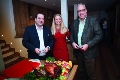 Thanksgiving Dinner - Daniel Riedl, Iris Einwaller and Peter Schnieper at the turkey cut.